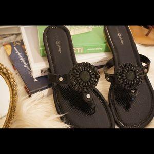 Interchangeable black patent leather flip flops